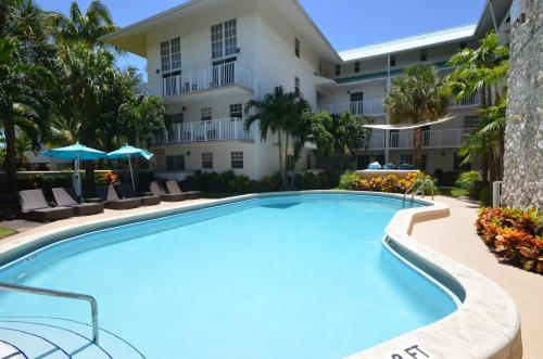 The swimming pool at or near Suites at Coral Resorts