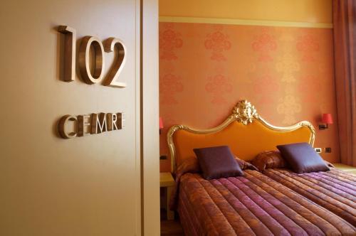 Un ou plusieurs lits dans un hébergement de l'établissement Hotel Cà Zusto Venezia