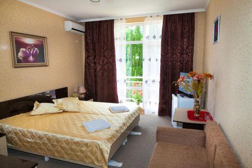 Кровать или кровати в номере Гостиница Камелия