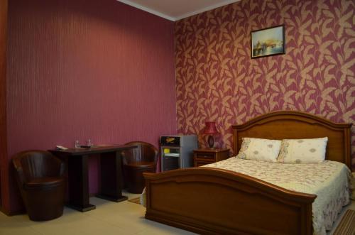 Кровать или кровати в номере Мини-Отель Альбатрос