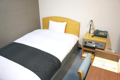 A bed or beds in a room at Hotel Abest Kochi