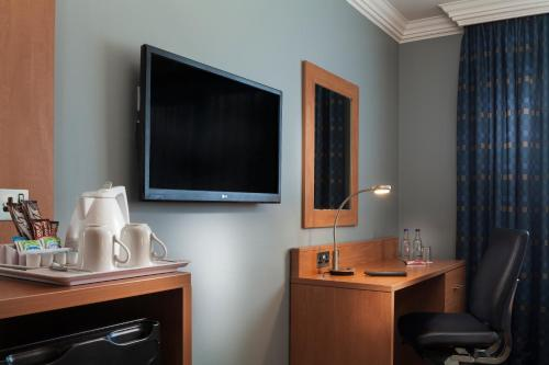 A television and/or entertainment center at Holiday Inn London Bloomsbury, an IHG Hotel