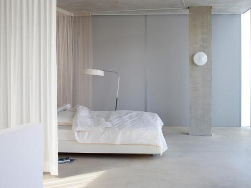 A bed or beds in a room at H-House Architectural Residence