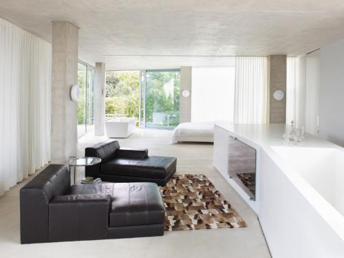 A seating area at H-House Architectural Residence