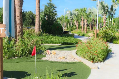 A garden outside Grand Beach Resort By Diamond Resorts