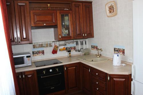 Кухня или мини-кухня в Апартаменты на Арбате