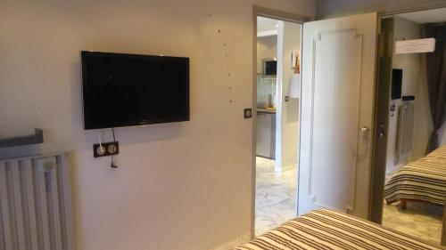 A television and/or entertainment center at One Bedroom Lacour 249