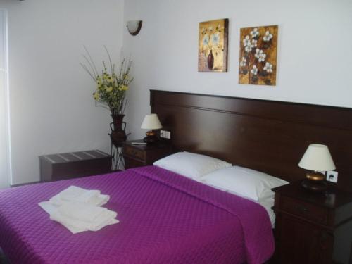 Ένα ή περισσότερα κρεβάτια σε δωμάτιο στο Rita's Place Hotel