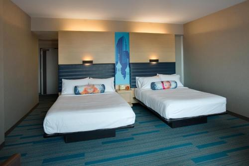 A bed or beds in a room at Aloft - Tampa Downtown