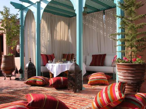 A porch or other outdoor area at Riad Kniza