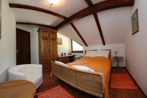 Un pat sau paturi într-o cameră la Vila Anastasia