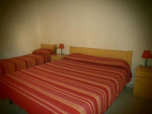A bed or beds in a room at Hotel Pensione Cundari
