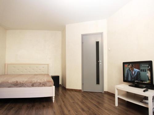 Телевизор и/или развлекательный центр в ApartLux Рижская
