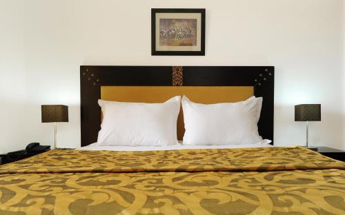 A bed or beds in a room at Farah Inn Ifrane