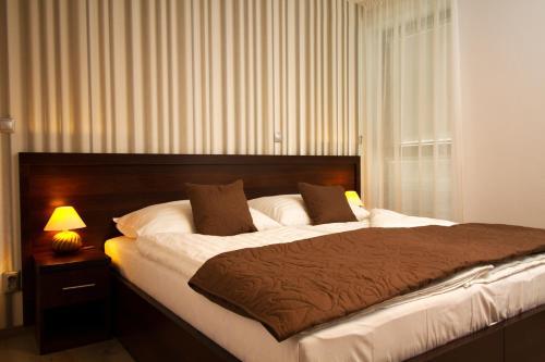 Posteľ alebo postele v izbe v ubytovaní La Pension