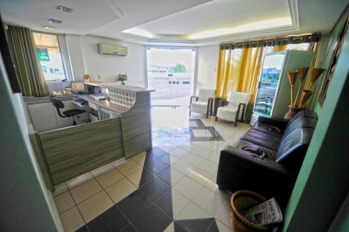A cozinha ou cozinha compacta de Capão Praia Hotel
