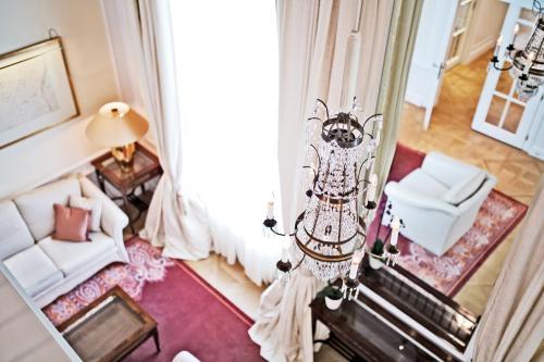 Гостиная зона в Palais Coburg Hotel Residenz
