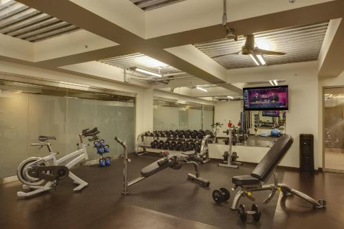 The fitness center and/or fitness facilities at The Madison Concourse Hotel