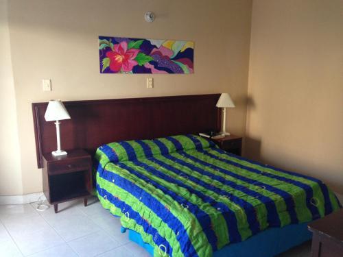 Кровать или кровати в номере Hotel Betoma