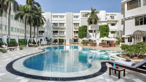 The swimming pool at or near The Claridges New Delhi