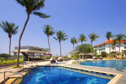 The swimming pool at or near Bandara International Hotel managed by AccorHotels
