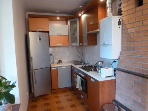 Кухня или мини-кухня в Aleksandrovskaya One