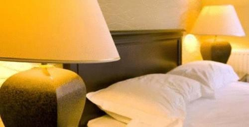 A bed or beds in a room at Lovat Arms Hotel