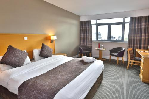 A bed or beds in a room at Best Western Plus Nottingham City Centre