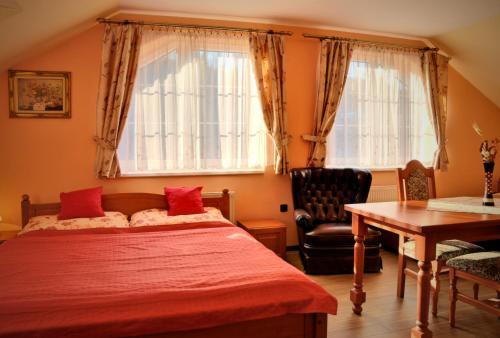 Postel nebo postele na pokoji v ubytování Zámeček Kaliště