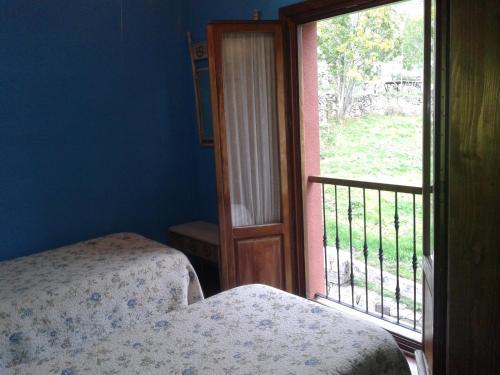 Cama o camas de una habitación en Apartamentos Cobrana