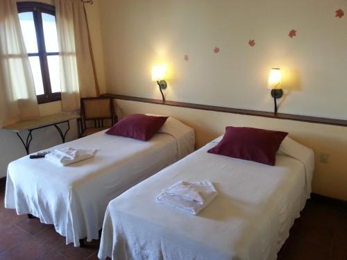 Cama o camas de una habitación en Hotel Patio del Malinche