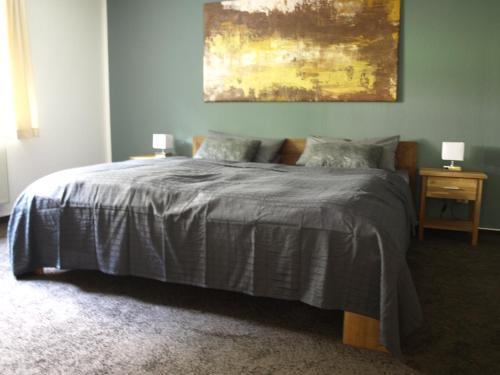 Кровать или кровати в номере Ferienwohnung Thüringen