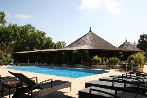 Het zwembad bij of vlak bij Le Saly Hotel & Hotel Club Filaos