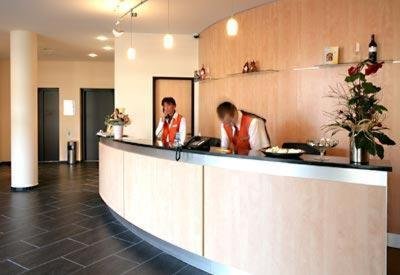 The lobby or reception area at Hotel Rhein-Ruhr Bottrop