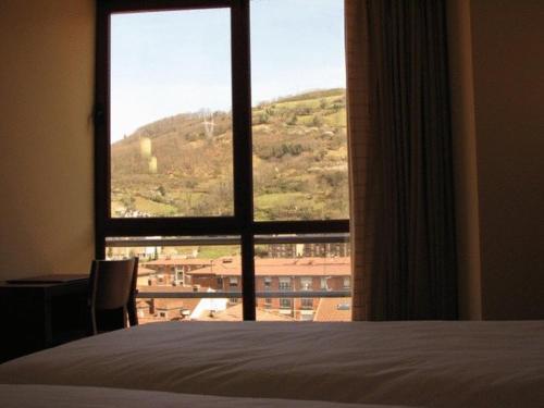 Cama o camas de una habitación en Hotel Ruta de la Plata de Asturias