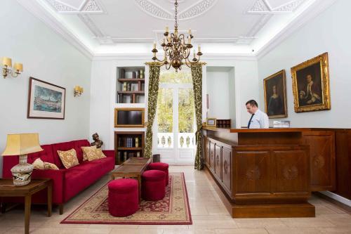 De lobby of receptie bij Hotel Dom Sancho I