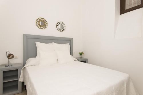 Cama o camas de una habitación en Apartmentos Plaza Nueva