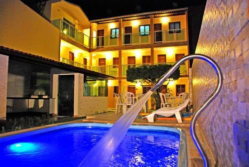 A piscina localizada em Pousada Badejo ou nos arredores