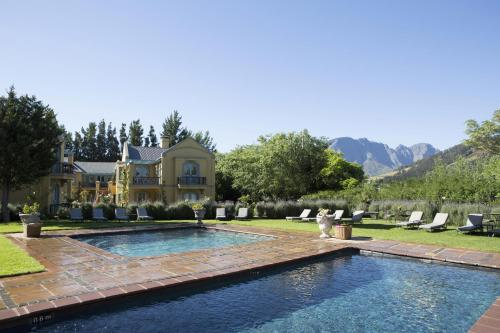 The swimming pool at or near Franschhoek Country House & Villas