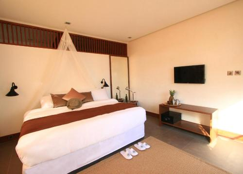 A bed or beds in a room at The Funny Lion