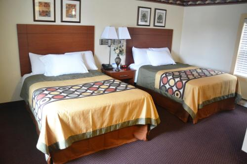 A bed or beds in a room at Scottish Inns Potsdam