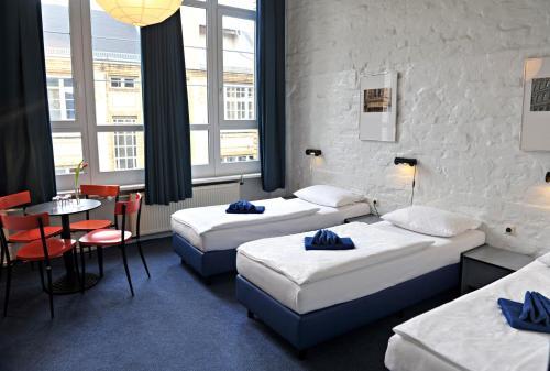Ein Bett oder Betten in einem Zimmer der Unterkunft Hotel Transit