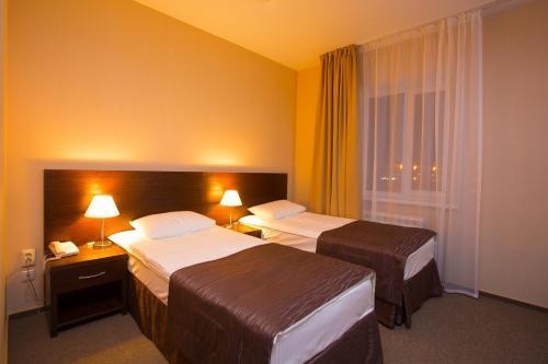 Кровать или кровати в номере Отель Рипосо