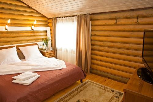 Кровать или кровати в номере Загородный клуб Белая Лошадь