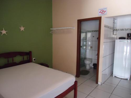 Cama ou camas em um quarto em Pousada do Beto
