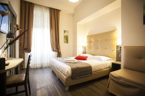A bed or beds in a room at Aventino Guest House