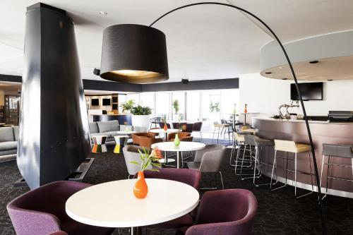 A restaurant or other place to eat at Novotel Breda