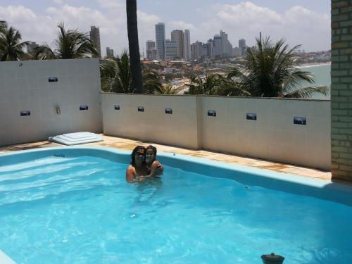 The swimming pool at or near Pousada Estacao Do Sol Natal