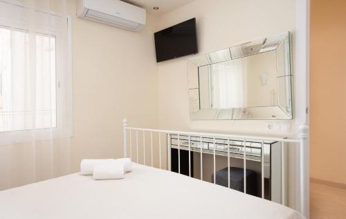 Cama o camas de una habitación en Barnapartments Rambla Cataluña
