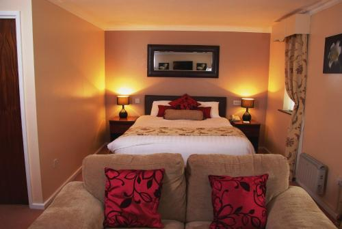 A bed or beds in a room at Beaufort Park Hotel